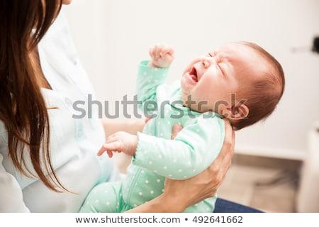 Baby piangere faccia giovani cute sfondo bianco Foto d'archivio © IS2