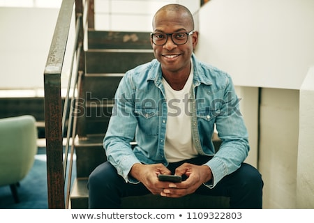 Young man on stairwell Stock photo © IS2