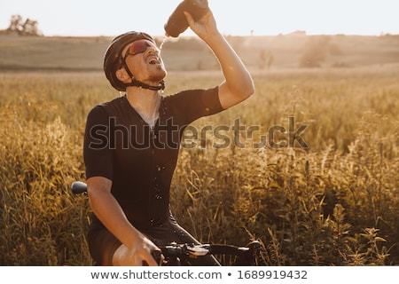 Cyclist drinking water Stock photo © IS2