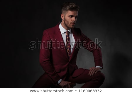 seductive stylish young man sitting while holding chair Stock photo © feedough