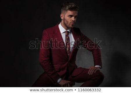 Csábító elegáns fiatalember ül tart szék Stock fotó © feedough