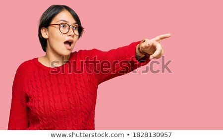 young brunette girl with glasses the girl points a finger forward stock photo © traimak