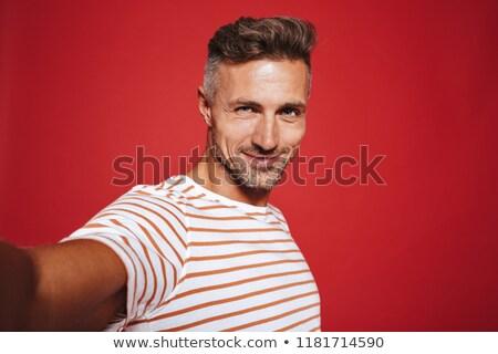 портрет · счастливым · человека · красный · капсула - Сток-фото © deandrobot