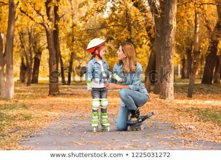 Mother and daughter roller skate Stock photo © bluering