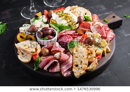 assortment of spanish tapas or italian antipasti stock photo © dash