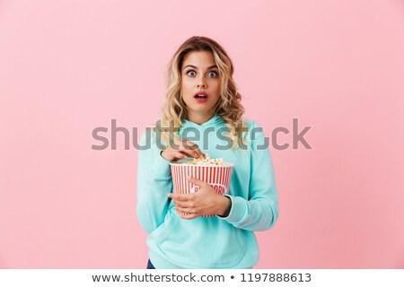genç · şaşırmış · kadın · yeme · patlamış · mısır · gri - stok fotoğraf © deandrobot