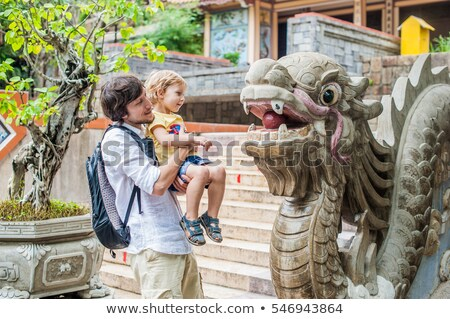 happy tourists dad and son in pagoda travel to asia concept traveling with a baby concept stock photo © galitskaya
