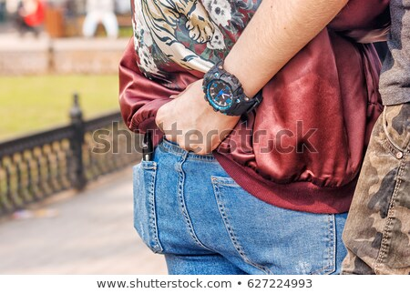 young casual man holding woman by waist stock photo © feedough