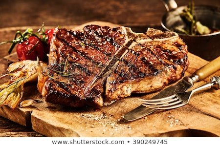 Foto stock: Grilled T Bone Steak On Wooden Board
