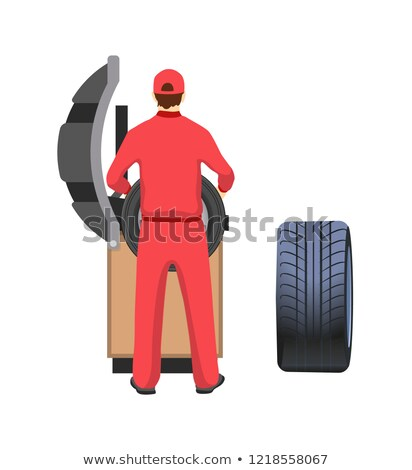 Car Tire Production Machine, Mechanic in Overalls Stock photo © robuart
