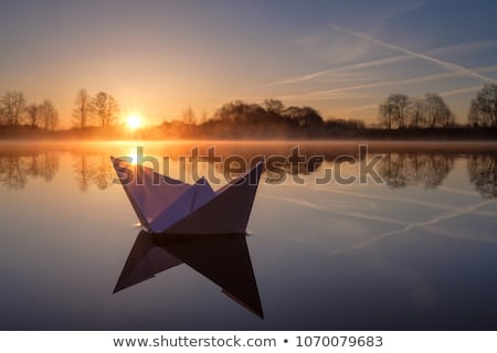 Paper boat floating along river Stock photo © colematt