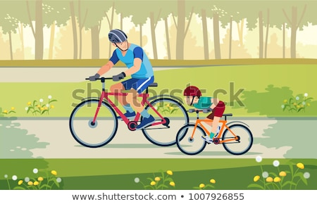 Stockfoto: Happy Family Is Riding Bikes Outdoors And Smiling Father On A Bike And Son On A Balancebike