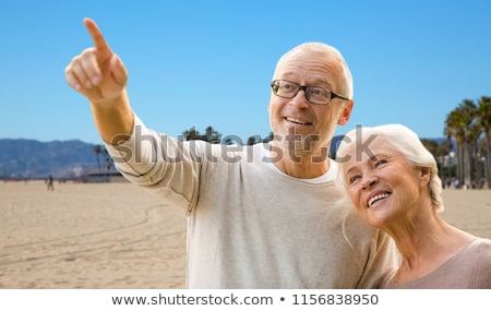 happy senior couple over venice beach background Stock photo © dolgachov