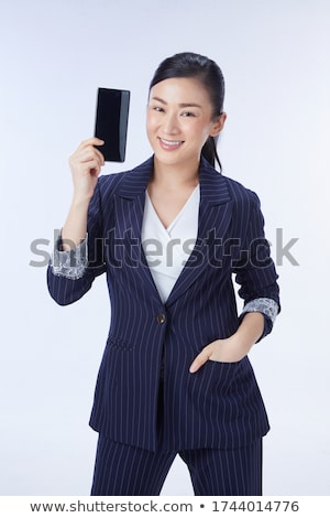 Asian beautiful woman isolated over blue background showing display of mobile phone. Stock photo © deandrobot