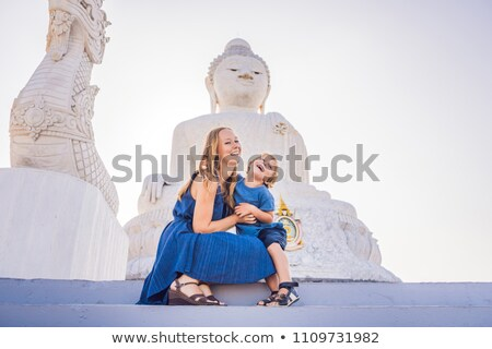 Mother and son tourists on the Big Buddha statue. Was built on a high hilltop of Phuket Thailand Can Stok fotoğraf © galitskaya