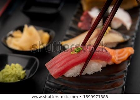 Sushi ingesteld houden hand geïsoleerd witte Stockfoto © OleksandrO