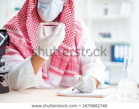 Arabian doctor studying bacteria Stock photo © pressmaster