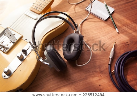 rock guitar player in headphones playing music on stage stock photo © loopall