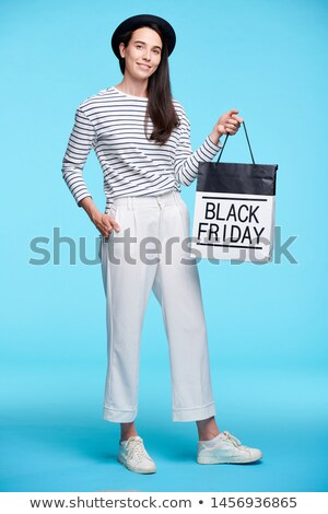 young female shopper in smart casual boasting with black friday purchase stock photo © pressmaster