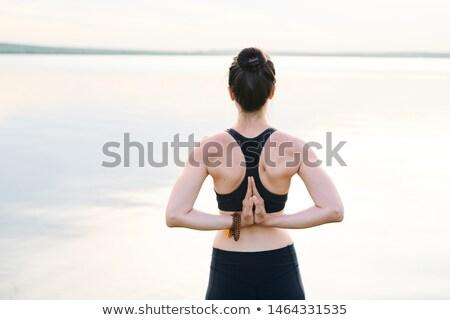 Genç kadın omurga ayakta deniz eller Stok fotoğraf © pressmaster