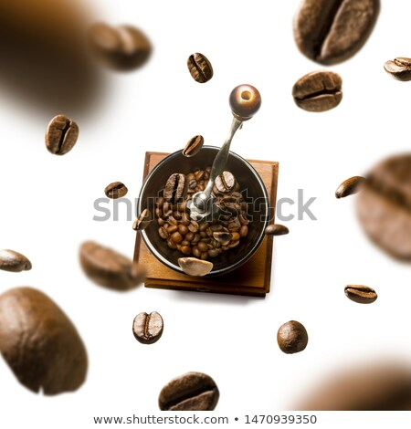 Coffee grinder and coffee beans in flight on white background Stock photo © butenkow