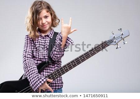 Sorridente menina jogar guitarra assinar Foto stock © Giulio_Fornasar