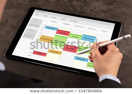 Mulher de negócios programar programa comprimido semanal negócio Foto stock © ra2studio