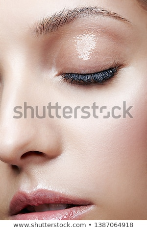 Close-up of woman's lips with bright fashion pink glossy makeup Stock photo © serdechny