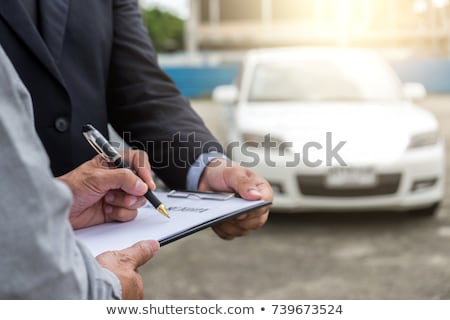 Insurance Agent examine Damaged Car and customer filing signatur Stock photo © Freedomz