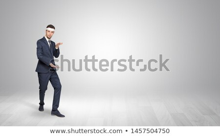 Karate trainer fighting in an empty space Stock photo © ra2studio