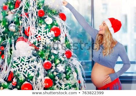 Pregnant woman adorns Christmas tree Stock photo © Anna_Om