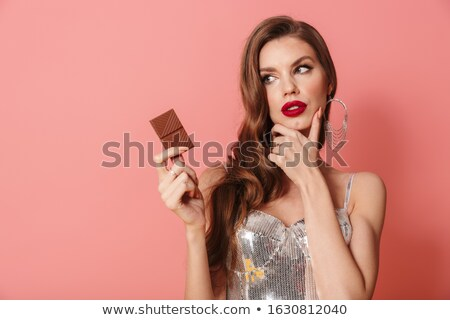 Woman in bright sequins dress holding chocolate. Stock photo © deandrobot