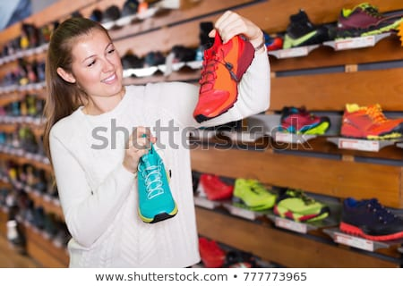 Young woman selecting shoes at a store Stock photo © dashapetrenko