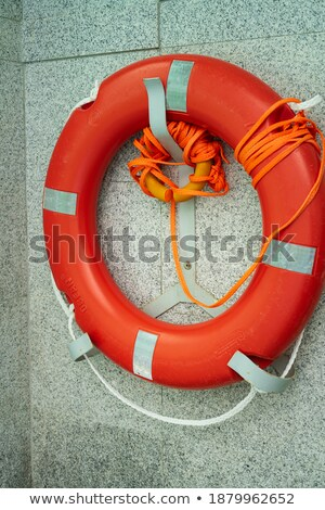 orange lifebuoy on fence stock photo © fisher