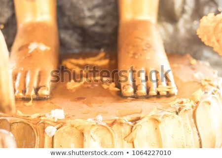 reclining gold buddha statue feet thailand stock photo © dmitry_rukhlenko