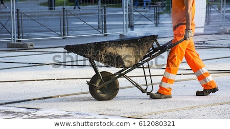 A construction worker with a wheelbarrow. Stock photo © photography33
