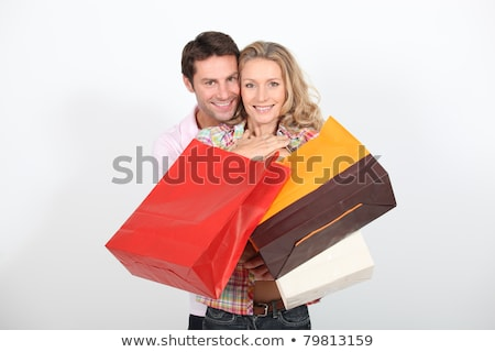 Woman holding numerous shopping bags Stock photo © photography33