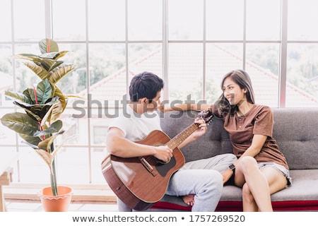 fiatalember · nő · fekszik · együtt · fehér · kanapé - stock fotó © CandyboxPhoto