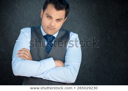 Business Man with Arms Folded and Unhappy Expression Stock photo © scheriton