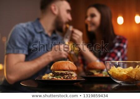 Young couple eating hamburgers Stock photo © photography33
