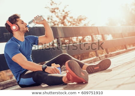a man drinking water after sport Stock photo © photography33