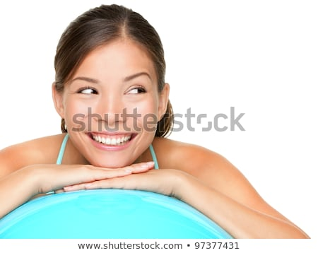 Close-up of a woman working out with a pilates ball  stock photo © wavebreak_media