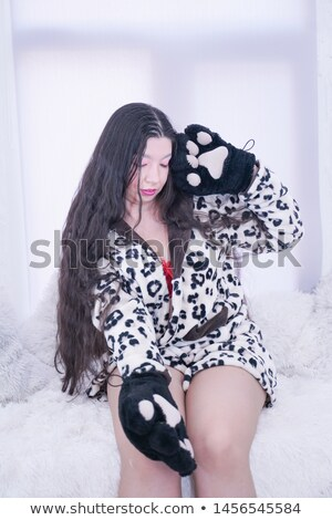 Pretty young brunette in gloves with claws Stock photo © acidgrey
