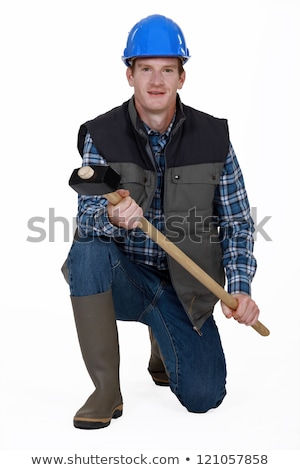 Man kneeling with sledge-hammer and wellington boots Stock photo © photography33