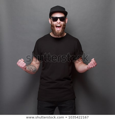 attractive adult man with glasses and black shirt Stock photo © juniart