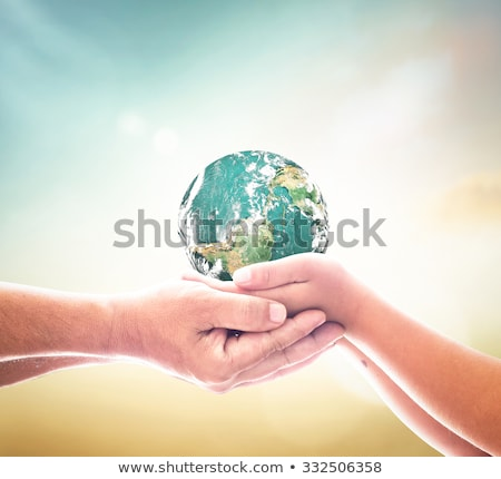 Holding / Helping the world with solidarity Stock photo © curvabezier