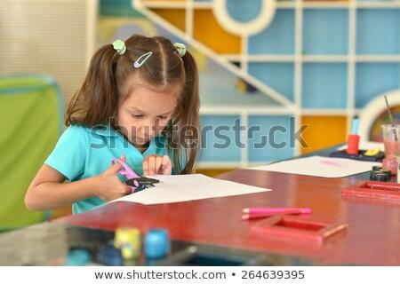 Little girl cutting paper stock photo © doupix