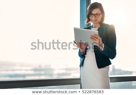 Woman with tablet at modern city Stock photo © Witthaya