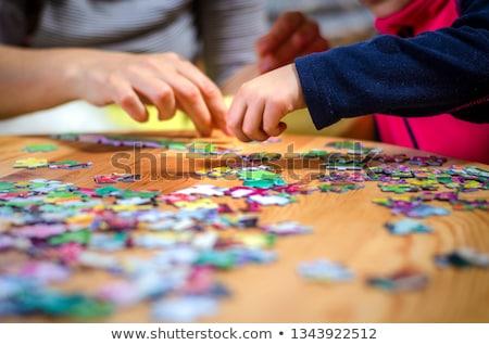 Chłopca puzzle młody chłopak odizolowany biały piętrze Zdjęcia stock © sdenness