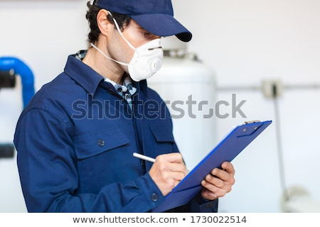 Plumber wearing gas mask Stock photo © joebelanger